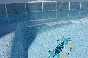Replacement of swimming pool tiles.